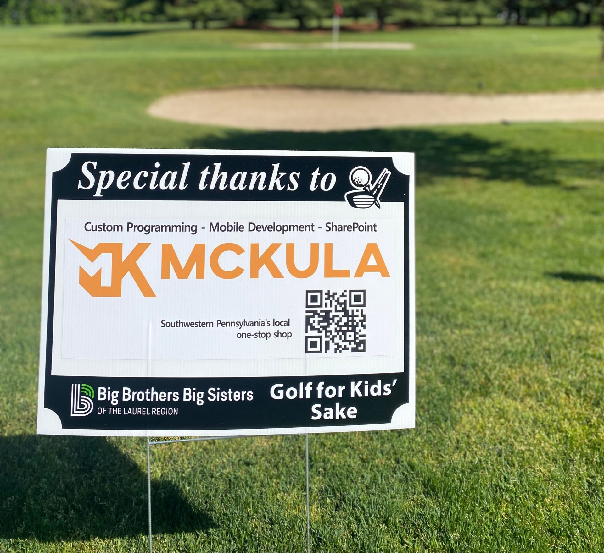 big brothers big sisters advertisement on golf course